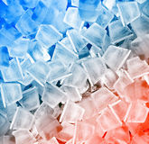 Ice cubes in blue light Royalty Free Stock Photos