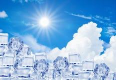 Ice cubes in blue sky. The ice cubes in blue sky royalty free stock photos