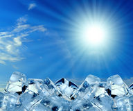 Ice cubes in blue sky Royalty Free Stock Photo