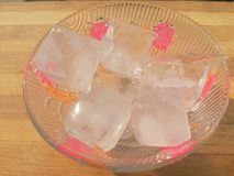Ice cubes in bowl Stock Images