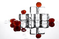 Ice cubes and cherries. Isolated on white background Royalty Free Stock Images