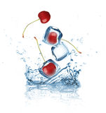 Ice cubes with cherry splashing into the water Royalty Free Stock Photos