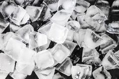 Ice cubes for a close-up drink on a black background. royalty free stock image