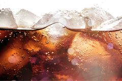 Ice cubes in cola beverage, close up. Cube beverage ice cola bar white background Stock Photo
