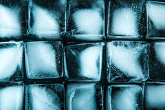 Ice cubes on the dark stone table  top view Stock Photos
