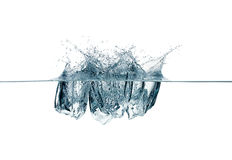 Ice Cubes Dropping. Splashes. Three Ice Cubes Dropping. Water Splashes Stock Images