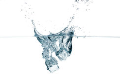 Ice Cubes Dropping. Splashes. Two Ice Cube Dropping. Water splashing Royalty Free Stock Photos