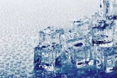 Ice cubes with drops Royalty Free Stock Photos