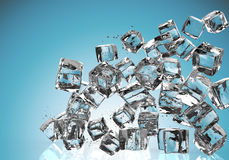Ice cubes falling on blue background Royalty Free Stock Photos