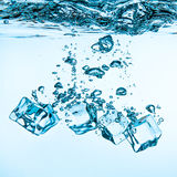Ice cubes falling under water Royalty Free Stock Image