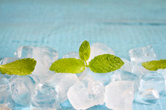 Ice cubes and fresh mint leaves abstract background Stock Photo