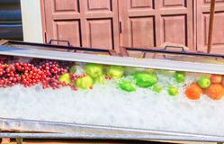 Ice cubes with Fruit in Glass cabinet and water drop with copy space add text stock image