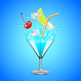Ice cubes and fruits falling into blue lagoon cocktail Royalty Free Stock Photography