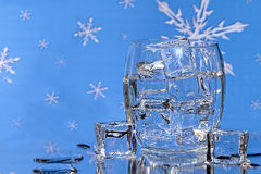 Ice Cubes in Glass - BlueSnowflake Background Stock Image