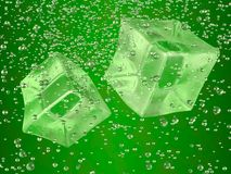 Ice cubes green. A couple of ice cubes swimming in green drink. Photorealistic 3D rendering Stock Illustration