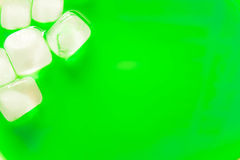 Ice cubes and green water background Royalty Free Stock Photo