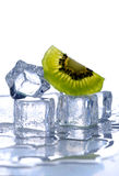 Ice cubes and kiwi Royalty Free Stock Image