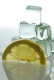 Ice cubes with lemon. Ice cubes melting and lemon slice Royalty Free Stock Images