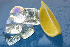 Ice cubes and lemon close Stock Photos