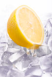 Ice cubes and lemon Stock Photos