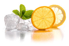 Ice cubes, lemon and orange Stock Photos
