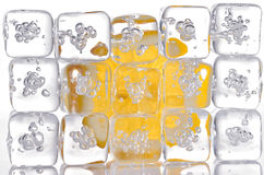Ice cubes and lemon slice Royalty Free Stock Photos