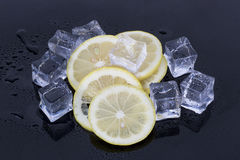 Ice cubes and lemon slices Stock Photos