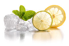 Ice cubes, lime and lemon. Stock Photos
