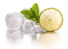 Ice cubes and lime Stock Photos
