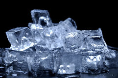 Ice Cubes. Melted ice cubes on black background Royalty Free Stock Photos