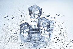 Ice cubes melting. Melting ice cubes on a metal tabletop Stock Images