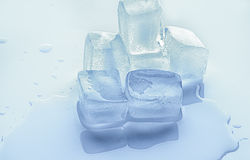 Ice cubes. That melts on the board Stock Photo
