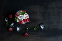 Ice cubes with mint leaves and frozen raspberry in glass on grunge dark background Royalty Free Stock Image