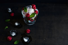 Ice cubes with mint leaves and frozen raspberry in Royalty Free Stock Photo