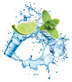 Ice cubes, mint leaves, water splash, lime and glass Royalty Free Stock Images