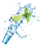 Ice cubes, mint leaves, water splash, lime and glass Stock Photos