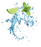 Ice cubes, mint leaves, water splash and lime Stock Photos