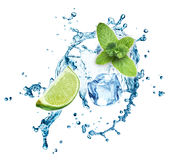 Ice cubes, mint leaves, water splash and lime Stock Images