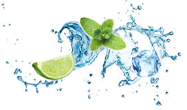 Ice cubes, mint leaves, water splash and lime Stock Photo
