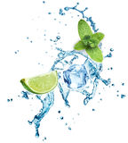 Ice cubes, mint leaves, water splash and lime Royalty Free Stock Photos