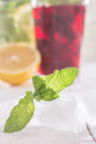 Ice cubes, mint and soft drink. On a wooden table Stock Photography