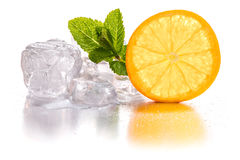 Ice cubes and orange Stock Photography