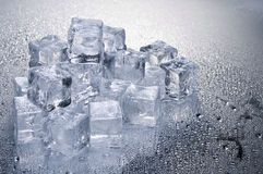 Ice cubes over wet background Stock Photos