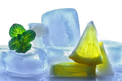 Ice cubes with pieces of lemon Royalty Free Stock Image