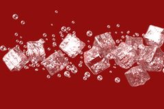 Ice cubes on a red background with bubbles. Royalty Free Stock Image