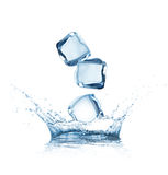 Ice cubes splashing into the water Stock Photography