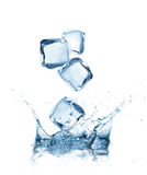 Ice cubes splashing into the water Stock Photo
