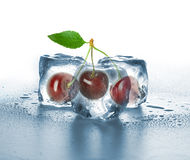 Ice cubes and sweet cherry Stock Images