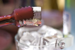 Ice cubes and tongs Royalty Free Stock Photos
