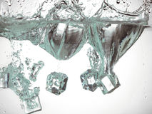 Ice cubes in water Stock Photography